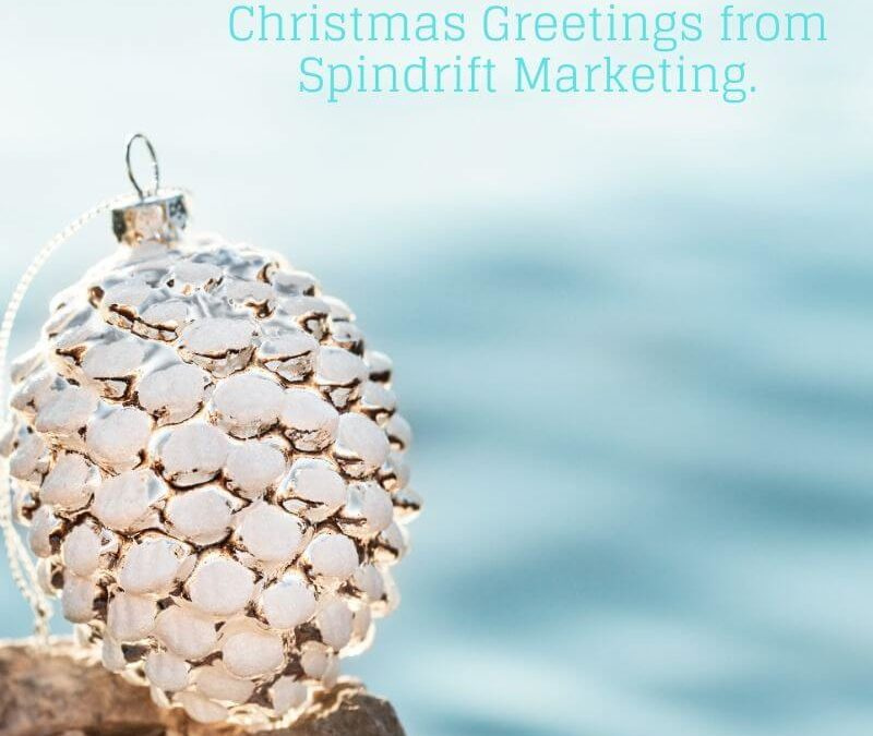 christmas decoration set on a rock by the sea