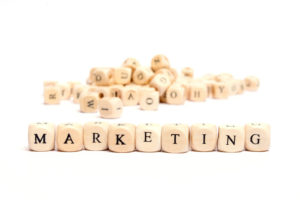 scrabble letters spelling out the word marketing