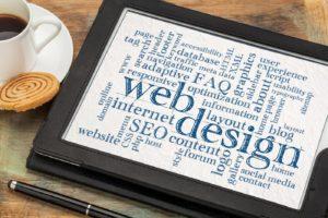 laptop computer with website design wording
